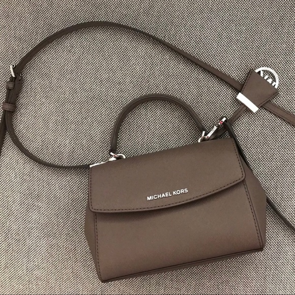 29d25aa898f9 MICHAEL Michael Kors Ava Extra-Small Saffiano. M 5c08b52b4ab6330686108fd3.  Other Bags ...